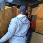 Football Hall of Famer Aeneas Williams repairs shattered storefronts in Ferguson