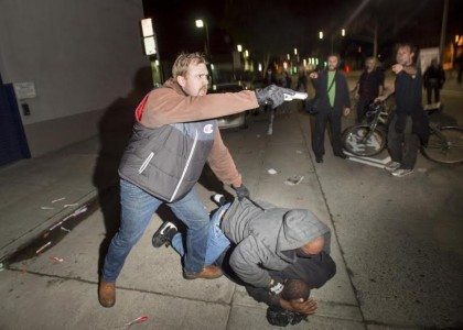 Officer points gun at crowd when partner attacked during anti-police protest in Oakland