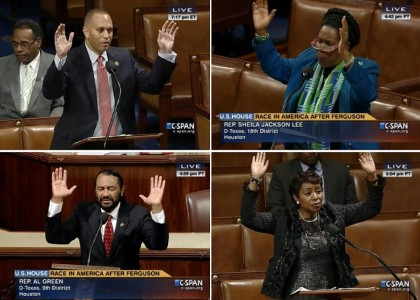Four Members of Congress do 'Hands Up' gesture on House floor