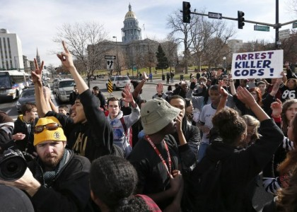 Denver student protesters cheered when car struck officer, union official says