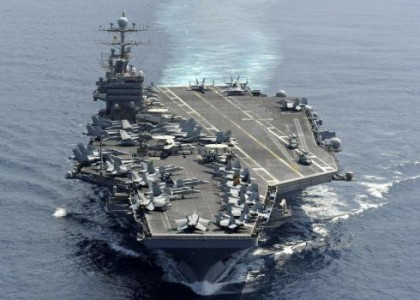 Officials giving mixed messages on why US aircraft carrier shadowing Iranian convoy