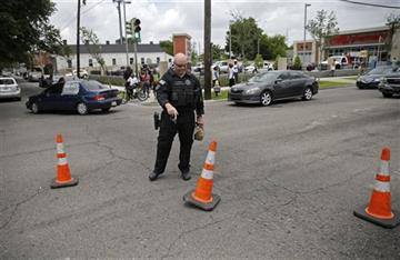 New Orleans police continue manhunt for man suspected of killing officer