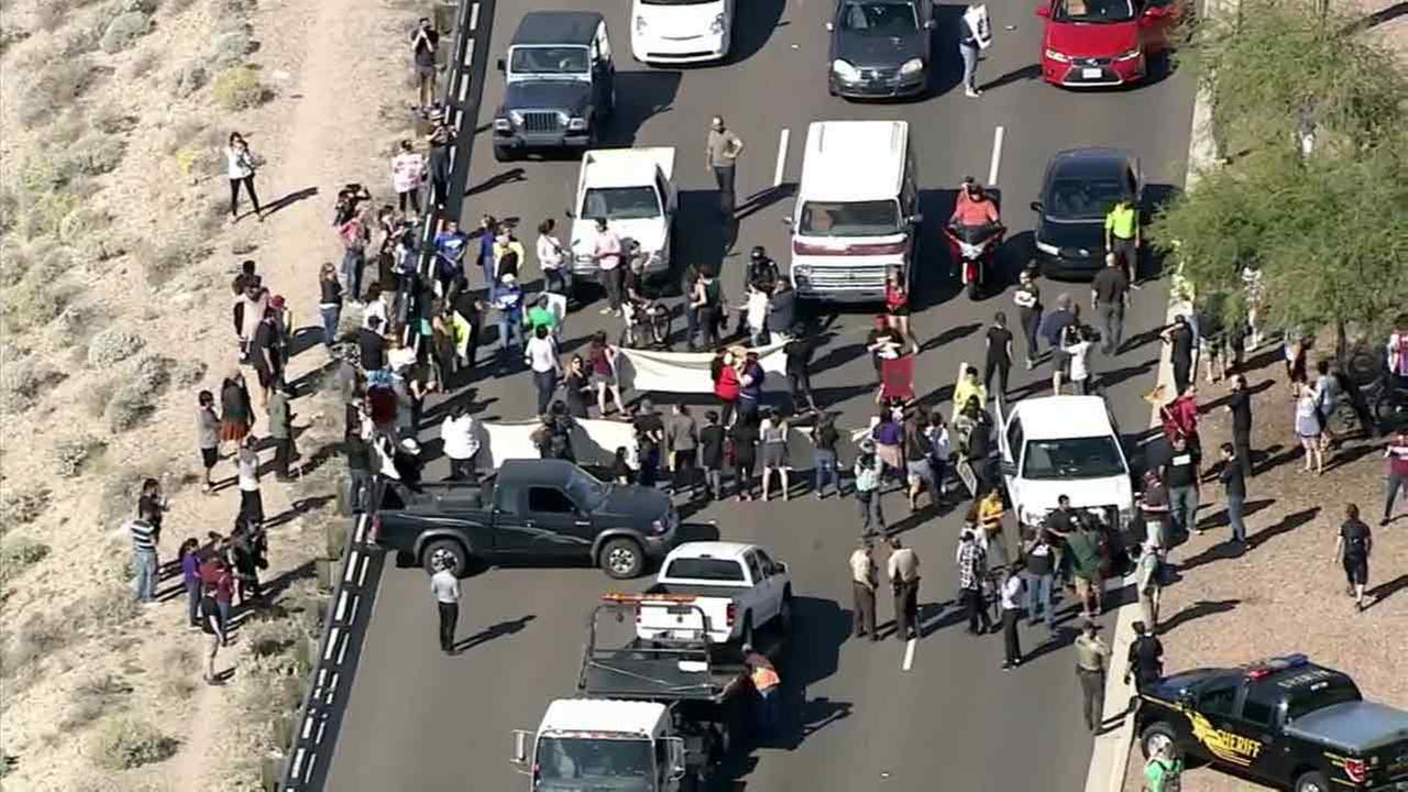 Protesters block the road to Donald Trump rally near Phoenix