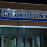 security guard leaves loaded gun in school bathroom, found by Student