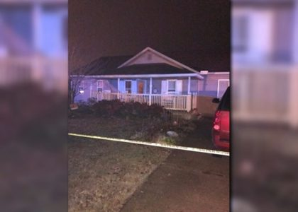 Woman shot by police after officers find 3 bodies at home