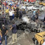 At least 22 killed after suicide bomber targets crowded Baghdad market