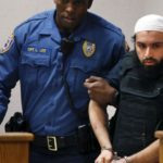 Bombing suspect's lawyer wants shootout charges dropped