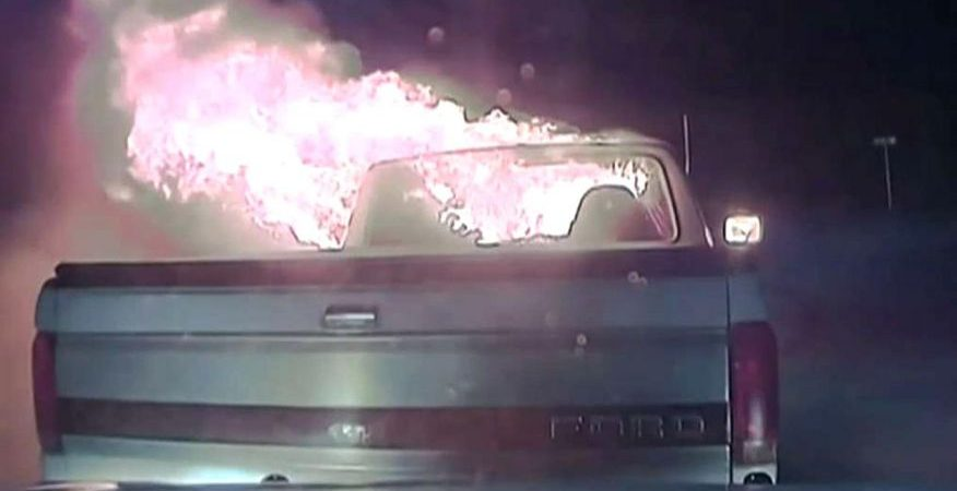 [VIDEO] Texas cop uses patrol car to push burning truck from restaurant