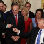 Trump Signs VA Accountability Act, Gives Pen to Double-Amputee