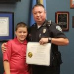 Cop ADOPTS abused ten-year-old boy after rescuing him from home