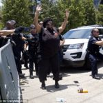 New Black Panthers are tasered and arrested during march to mark death of Alton Sterling