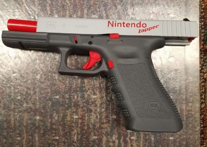 Gun painted like Nintendo 'Zapper,' 17 other weapons found at home of St. Louis County rape suspect