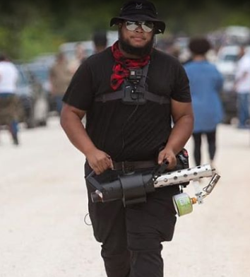 Arkansas Black Lives Matter group confronted by an armed militia One protester armed with flamethrower